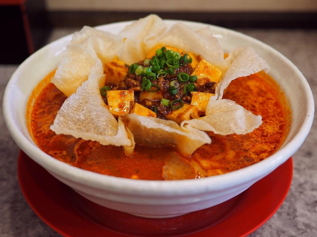 絶品の濃厚旨辛味噌ベースのラーメンに麻婆豆腐が乗っかった新感覚の麻婆ラーメンは感動的な美味しさです! 関目高殿 「男のラーメン 関目団長」