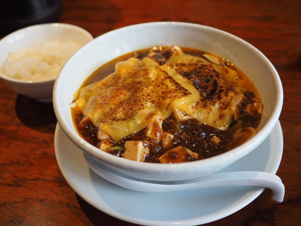 大人気の痺れる麻婆麺に焼きチーズトッピングバージョンが登場しました! 梅田 「SHIBIRE-NOODLES 蝋燭屋」